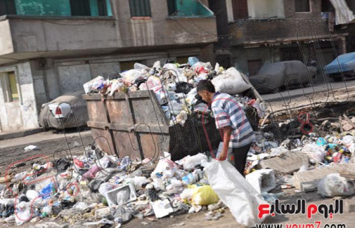 بالصور..القمامة تغطى شوارع شبرا الخيمة بالقليوبية