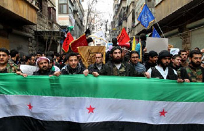 الآلاف يتظاهرون بالعراق احتجاجا على الضربة العسكرية المحتملة ضد سوريا