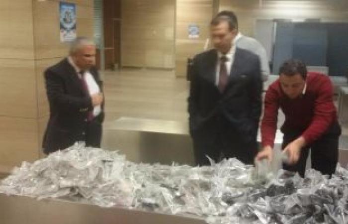 بالصور.. إحباط أكبر محاولة لتهريب كميات هائلة من النظارات بمطار القاهرة