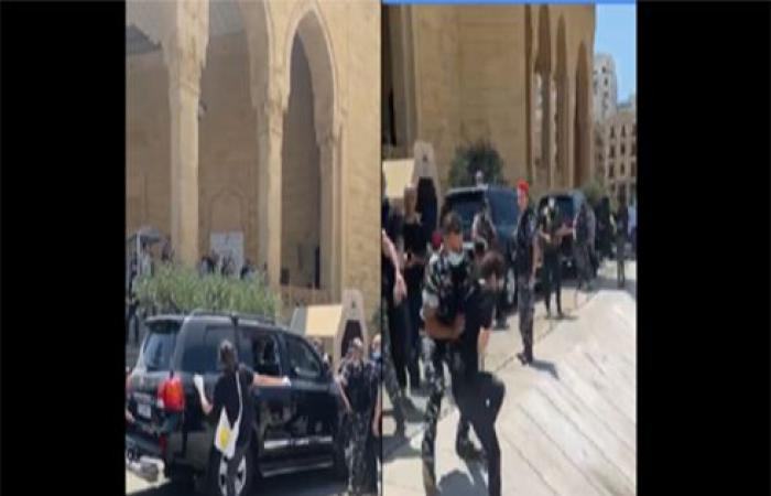 محتجون يعترضون موكب الحريري في وسط بيروت .. بالفيديو