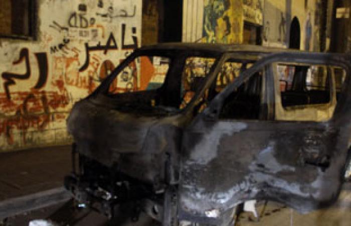 أنصار الإخوان يحرقون سيارة شرطة ويخربون واجهات المحلات فى أسيوط