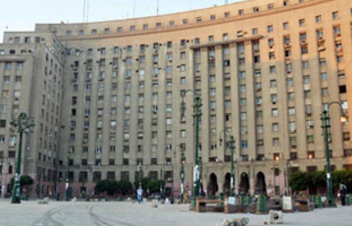 المواطنون يرسمون الهلال والصليب بالليزر على مجمع التحرير