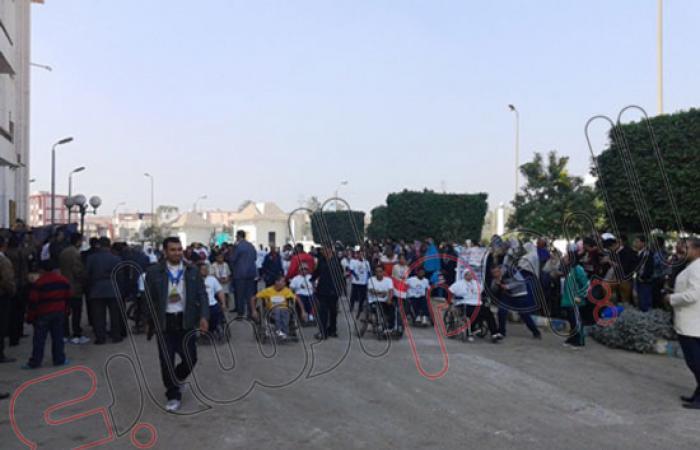 بالصور.. جامعة بنى سويف تنظم مارثونا رياضيا للمعاقين