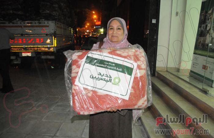 """بالصور.. """"حديد المصريين"""" تنتهى من توزيع 20 ألف بطانية"""