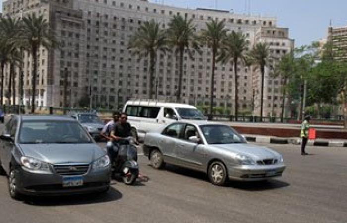 انتظام حركة المرور أمام السيارات فى شوارع القاهرة والجيزة