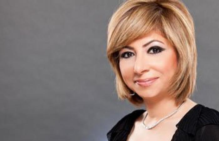 """لميس الحديدى تغازل عمرو أديب بـ""""هنا العاصمة"""": أكثر وسامة من جورج كلونى"""