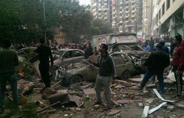"""النيابة تنتقل لمعاينة انفجار عقار """"فيصل"""" والمعمل الجنائى يرفع الأدلة"""