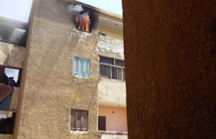 اشتعال النيران فى شقة سكنية بمنطقة المنيب والأطفاء تسيطر عليه