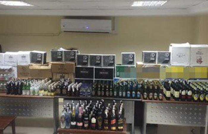 ضبط 2000 زجاجة خمر بمخزن لبيع المشروبات الكحولية بدون ترخيص بالشيخ زايد