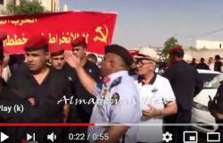 بالفيديو : جدال بين ضابط ومواطن بسبب اغلاق الشارع خلال مسيرة السفارة الامريكية
