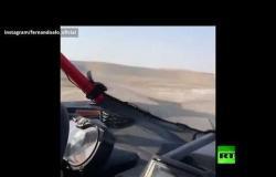 """الإسباني ألونسو يقود سيارة """"تويوتا"""" رفقة القطري العطية على الكثبان الرملية"""