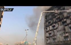 صعود الدخان فوق بناية التأمين الوطنية في بغداد