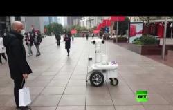 """على هامش """"كورونا"""".. روبوت يقوم بدور الشرطة في الصين"""
