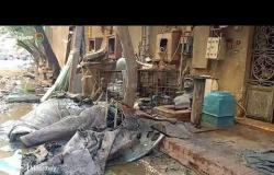 مشاهد من حريق مسجد وعقار مكون من ٤ طوابق بالهرم
