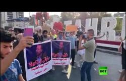 صحفيون ونشطاء يقيمون تشييعا رمزيا لهشام الهاشمي وسط بغداد