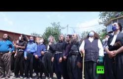 طقوس خاصة في السليمانية شمالي العراق أثناء مراسم تشييع زعيم الطريقة الكسنزانية