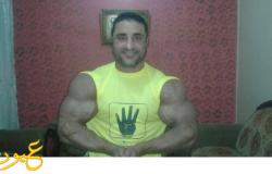 بعد أبطال الكونغ فو بطل مصر فى كمال الأجسام يرتدي تيشيرت رابعة