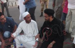 بالصور.. راعى كنسية النبى موسى بجنوب سيناء يشارك المسلمين إفطارهم