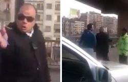 بالفيديو.. مشاجرة بين أمين شرطة ومواطن فى الشارع